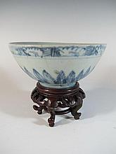 Vintage Chinese porcelain bowl with a wood base