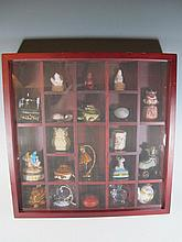 Display cabinet with cinnabar, porcelain & enamel boxes