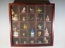Display cabinet with resin, porcelain & enamel boxes