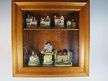 Display cabinet with 8 resin houses models