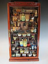 Display cabinet with 45 porcelain boxes