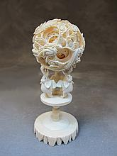 Old Chinese carved ivory puzzle ball with stand