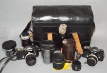 2 Nikon SLR Cameras with Lenses