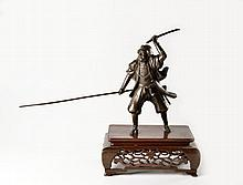 A LARGE BRONZE OKIMONO FIGURE OF A SAMURAI