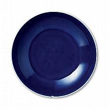 A SMALL BLUE-GLAZED DISH