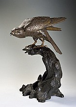 A BRONZE FIGURE OF A SITTING BUZZARD