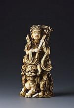 AN IVORY OKIMONO OF THE BODHISATTVA MANJUSHRI