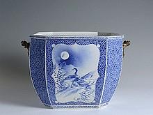 A LARGE OCTAGONAL BLUE AND WHITE PORCELAIN JARDINIÈRE