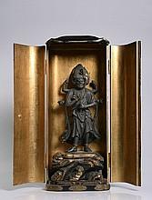 A LARGE ZUSHI WITH A FIGURE OF MARISHITEN