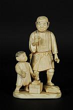 Groupe en ivoire sculpté et patiné représentant un