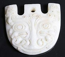 Carved white jade. Stylized face chinese