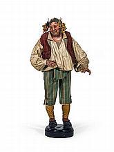 Personnage de crèche napolitain en bois polychrome et tissu représentant un personnage bacchique.    Travail italien, XIXe siècle.