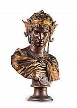 Buste de Dalila.    Épreuve en bronze à patine médaille et or, sur piédouche, signée, située et datée Rome 1872.