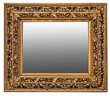 Miroir en bois sculpté et doré à front renversé et décor ajouré d'une frise de feuilles découpées.    Glace bordée d'une guirlande de fleurs enroulée d'un ruban.