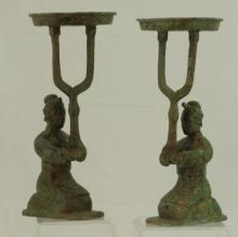 A Pair of Bronze Oil Lamps