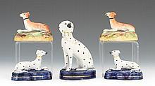 Five Staffordshire Dog Figurines