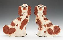 A Pair of Staffordshire Dog Figures