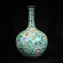 QING OR LATER, QIANLONG MARK., A GREEN GROUND FAMILLE ROSE VASE