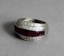 A mid 20th Century Continental white metal (thought to be platinum) ruby and diamond ring of Art Dec