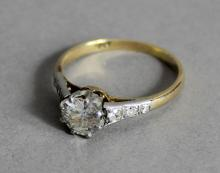 An 18ct gold and platinum mounted diamond solitaire ring, the central diamond of approx 0.50ct, shou