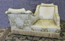 A late Victorian/Edwardian two seat conversation/love seat, with square backs,  upholstered in old g