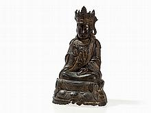 Meditative Bronze of a Guanyin on a Lotus Base in Relief, Ming