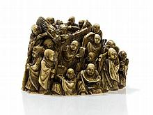 Singed Ivory Netsuke of a Group of Monks with Dragon, Meiji