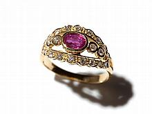 An elegant 18 carat yellow gold ring with ruby and 22 diamonds