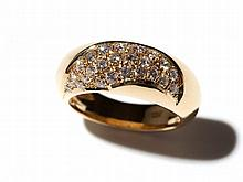 18 carat yellow gold ring with diamonds in a curved form