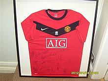 Signed and Framed Manchester United Team Signed Shirt 2009/2010.