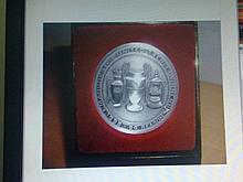 Commerative coin in a case to celebrate the Treble Season Glory