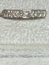 18 karat white gold diamond band.