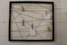 Framed Decorative art: Hanging Wicker Wreath and Clothespin Reminders
