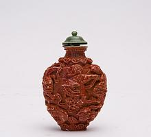 A CARVED PORCELAIN SNUFF BOTTLE