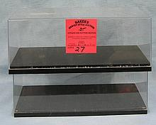 Pair of clear plastic display cases