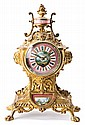 French gilt-bronze and porcelain table clock, late 19th century Paris movement. Does not chime. In working order