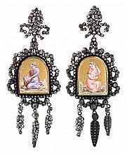 Long earrings, probably French, circa 1870 In carved steel and central plaques in enamelled glass depicting two female figures. Small o
