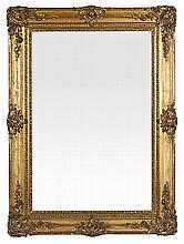 A gold-plated carved wood and stucco Elisabethan mirror from the mid 19th century