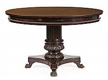 A carved mahogany dinning room table in Victorian style, from the early 20th Century