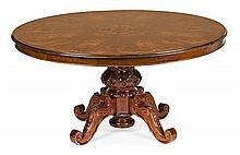 Dutch-style table in walnut and carved and stained beech with fine wood inlay, mid 20th Century 78x160 cm in diam.