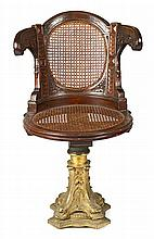 Swivel chair, probably Victorian, in carved mahogany with gilt-bronze foot, second half of the 19th Century Decorated with dolphin's h