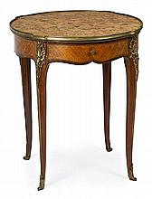 A rosewood French centre table in Louis XV style with gold-plated bronze decorations, from the early 20th Century