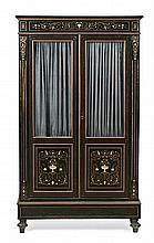 An ebony wood bookcase in Napoleon III style with brass and carved and inked bone Boulle marquetry and with gold-plated bronze decorati