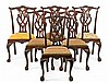 A set of six carved mahogany chairs in Chippendale style, from the mid 20th Century