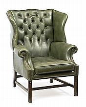 A mahogany English wing chair, from the mid 20th Century Leather upholstery