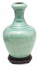 A celadon porcelain Chinese vase, from the 18th Century Wooden stand
