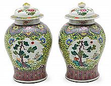 Pair of Chinese porcelain baluster vases and covers, early 20th Century