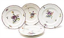 Set of two pairs of German Ludwigsburg flat and deep porcelain plates, 18th Century