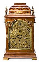English bracket table clock with mahogany box with fine wood inlaid and brass mounts and top decoration, first half 19th Century