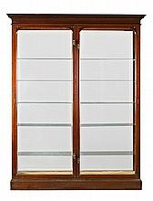 English mahogany cabinet with glass shelves, first quarter 20th Century